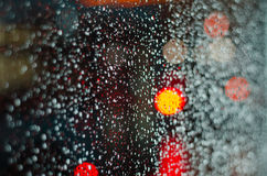 Rain drops. On glass with blurred background Royalty Free Stock Photos