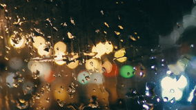 Rain drops on the glass close-up stock footage