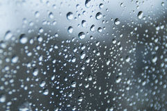 Rain drops on glass close up. In rainy weather on the glass of the car drops are formed. In the photo background of these drops royalty free illustration