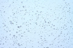 Rain drops on glass closeup Royalty Free Stock Image