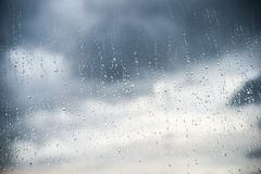 Rain drops on glass with dark cloud Stock Photography