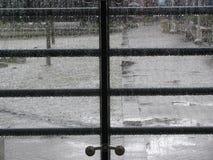 Rain drops on the glass panels Stock Photo