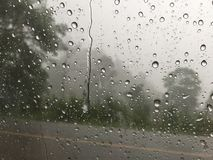 Rain drops on the glass. In a rainy days stock image