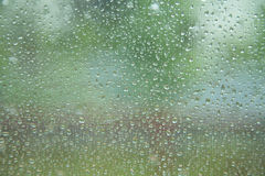 Rain drops on glass window Royalty Free Stock Photo