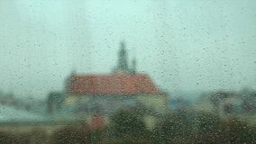 Rain Drops on the Glass of a Window, with Defocused Buildings in the Background.  stock footage