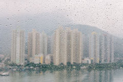 Rain drops on the glass windows with modern office building background Royalty Free Stock Photography