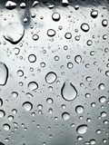 Image of raindrops in great contrast. Rainy season. Rain drops in good contrast for backgrounds and textures of artistic and editing works stock images