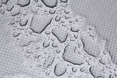 Rain drops on metalic surface Royalty Free Stock Photography