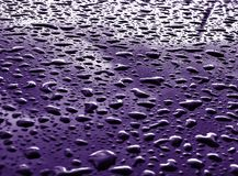 Rain drops on metallic surface Royalty Free Stock Photography