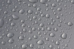 Rain drops on metallic surface Stock Photos