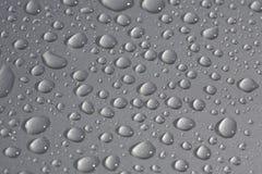 Rain drops on metallic surface. Closeup Stock Photos