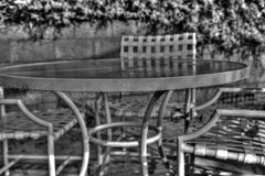 Rain drops on the patio table Stock Image