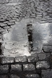 Rain drops on a puddle. A puddle in Piazza San Giovanni, Rome, Italy Royalty Free Stock Images