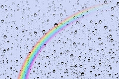 Rain drops and rainbow. In background Royalty Free Stock Image