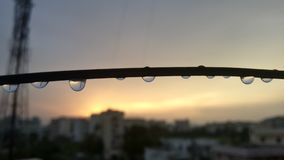 Rain drops with reflection. Rain drops on clothes line with reflection in them Royalty Free Stock Photography