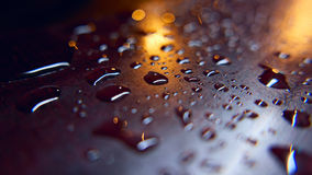 Rain drops on a surface. Abstract background Stock Photo