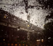 Rain drops on the surface of the car mirror reflecting light into small droplets. royalty free stock image