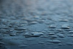 Droplets on a table outside stock image