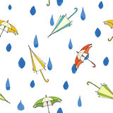 Rain drops and umbrella seamless pattern. Hand drawn vector illustration. Royalty Free Stock Image