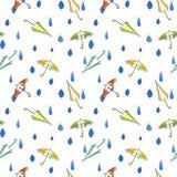 Rain drops and umbrella seamless pattern. Hand drawn vector illustration. Stock Images