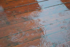 Rain and drops of water. Patio flooded with rain.storm. Rainy day. Terrace. Outdoor Stock Image