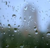 Rain drops on a window. And mystic silhouette of city Royalty Free Stock Photos