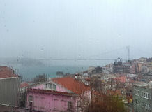 Rain drops on window against buildings in Istanbul, Turkey Royalty Free Stock Photos