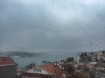 Rain drops on window against buildings in Istanbul, Turkey Stock Photography