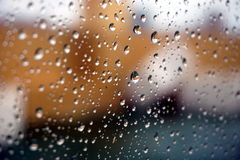 Rain drops on window, balcony in background Stock Photo