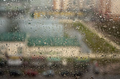 Rain drops on window with blur effect. Abstract background for design Royalty Free Stock Images