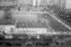 Rain drops on window with blur effect in black and white. Abstract background for design Stock Photo