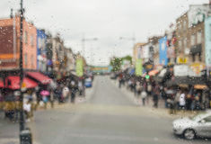 Rain drops on window. Blured colorful cityscape on a background. Royalty Free Stock Photography