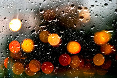 Rain Drops on window with bokeh effect Stock Images