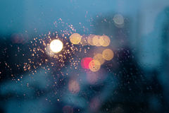 Rain drops on the window. With bokeh lights from street Royalty Free Stock Images