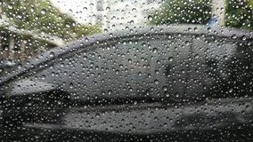 Rain drops on window with car. Rain drops on window with car background Royalty Free Stock Image