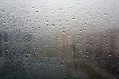 Rain drops on window close-up. Abstract seasonal background and texture Stock Image