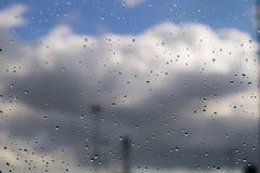 Rain drops on window. Cloudy sunny day rain drops on window royalty free stock photography
