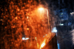 Rain drops on the window with dark streets outside Royalty Free Stock Photography