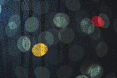 Rain drops on the window, and defocused city lights Stock Photo