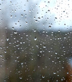 Rain drops on window glass on autumn day closeup Royalty Free Stock Image