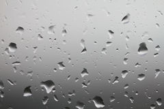 Rain drops on window glass. Clean water drops on defocused view window glass Stock Photography
