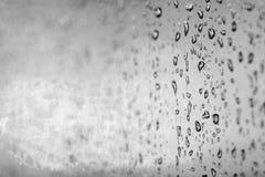 Rain drops on a window glass Stock Photos