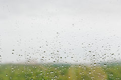 Rain drops on window glass Royalty Free Stock Photography
