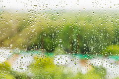 Rain drops on window glass in summer day Royalty Free Stock Photos