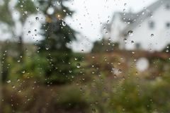 Rain drops on window glass with view to the countryside Royalty Free Stock Photos