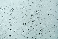 Rain drops on window glasses surface with cloudy background . Rain drops on window glasses surface with cloudy background Stock Photography
