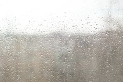 Rain drops on window glasses surface with cloudy background . Natural Pattern of raindrops royalty free stock images