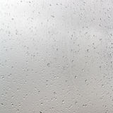 Rain drops on window pane in cloudy day Stock Photography