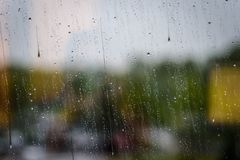 Rain drops on window pane. Blurred for effect for background use Royalty Free Stock Image