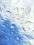 Rain drops on window. Photo of rain drops on window with view of clouds and sky stock image